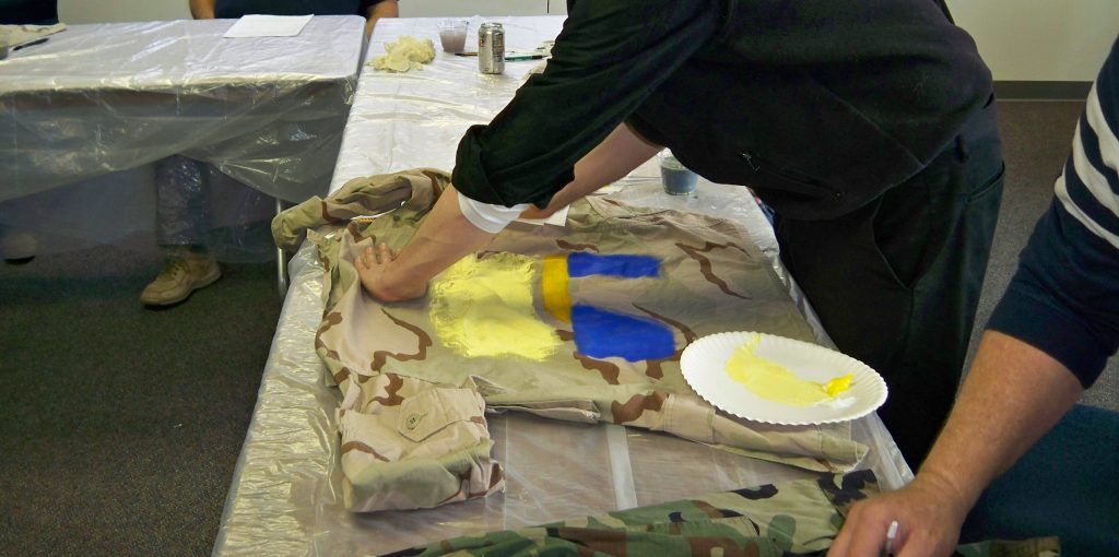 Photo of two Veterans painting